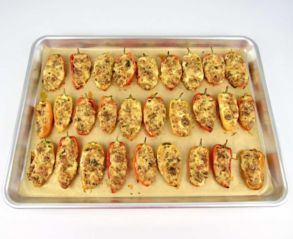 chorizo stuffed mini peppers on baking sheet