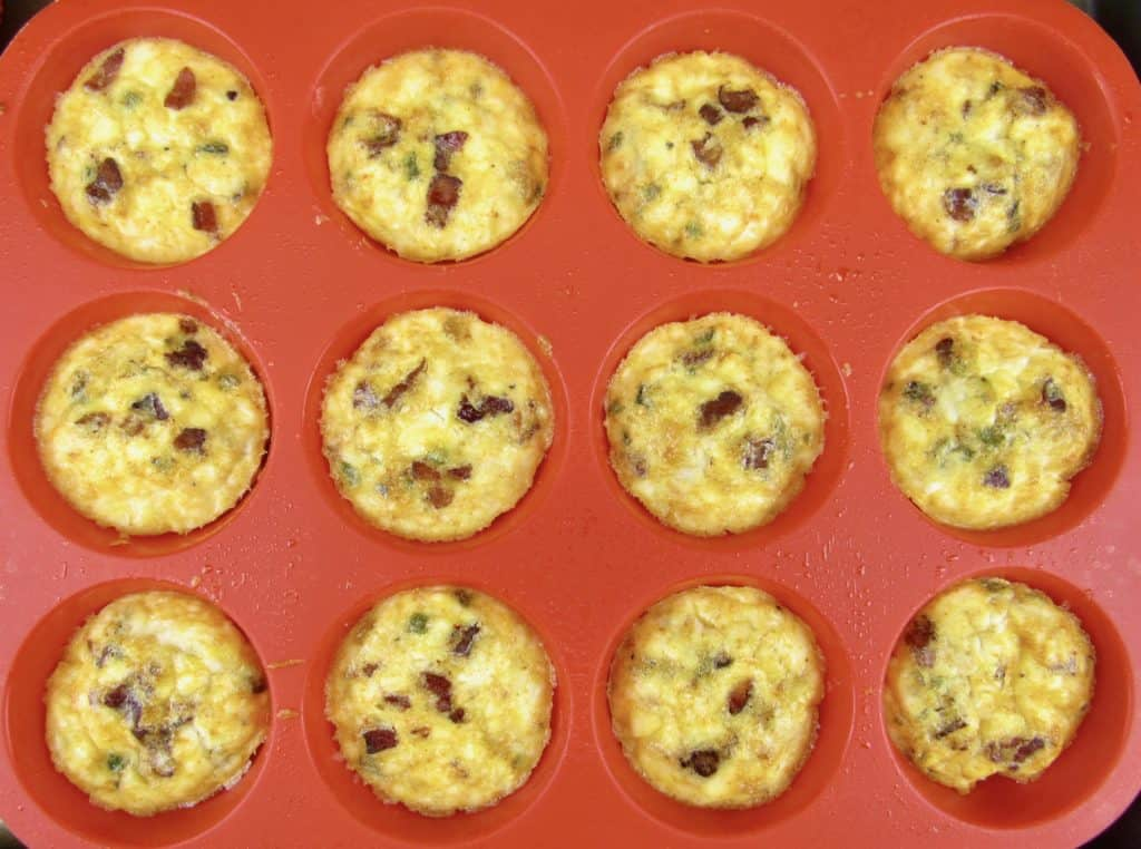 overhead view of Jalapeño Popper Egg Cups in red silicone pan