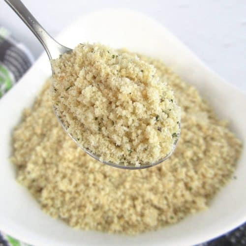 Keto Bread Crumbs in white bowl with spoon holding up some