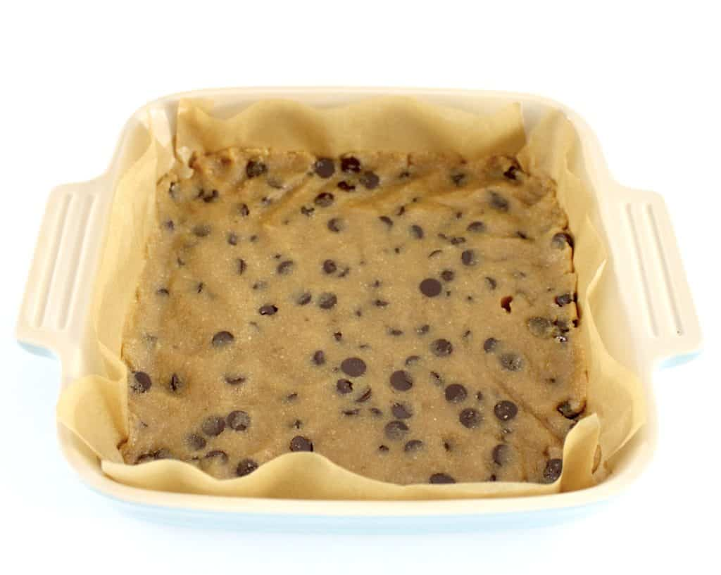chocolate chip cookie bars crust in casserole dish