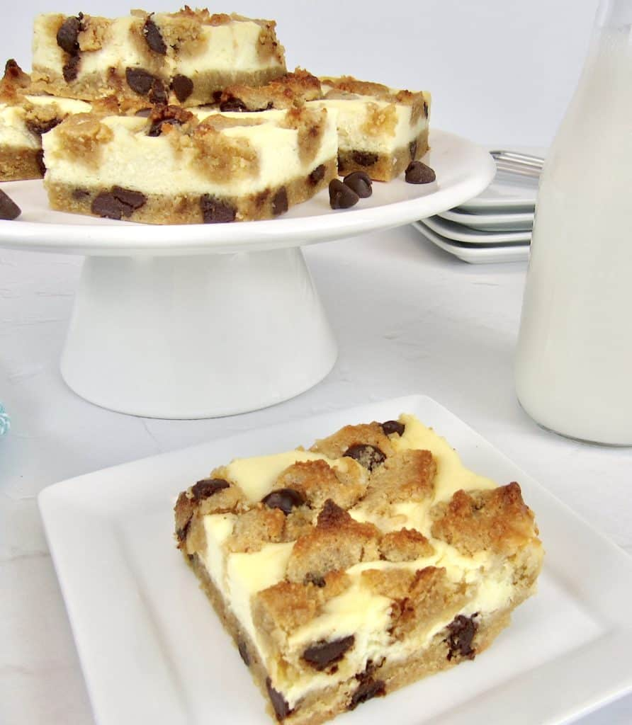 chocolate chip cookie bars on stand with one on plate