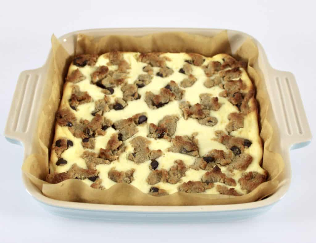 Keto Chocolate Chip Cookie Bars batter in baking dish baked