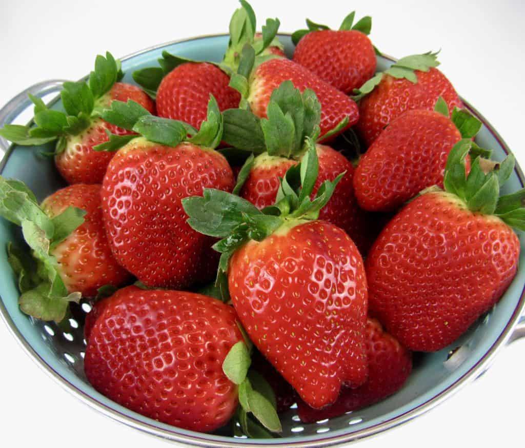 strawberries in collander
