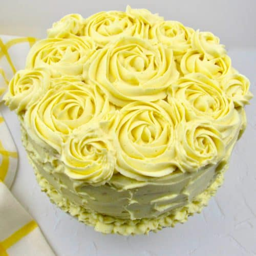 lemon cake with rosettes on top