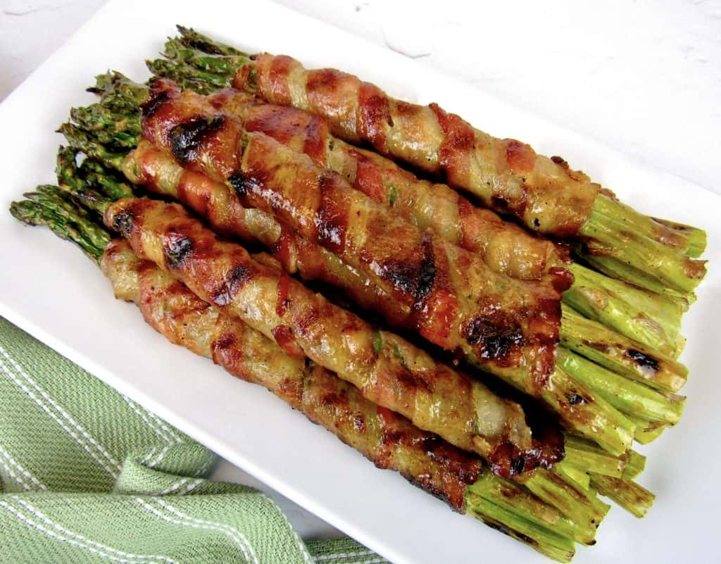 Grilled Bacon Wrapped Asparagus on white plate