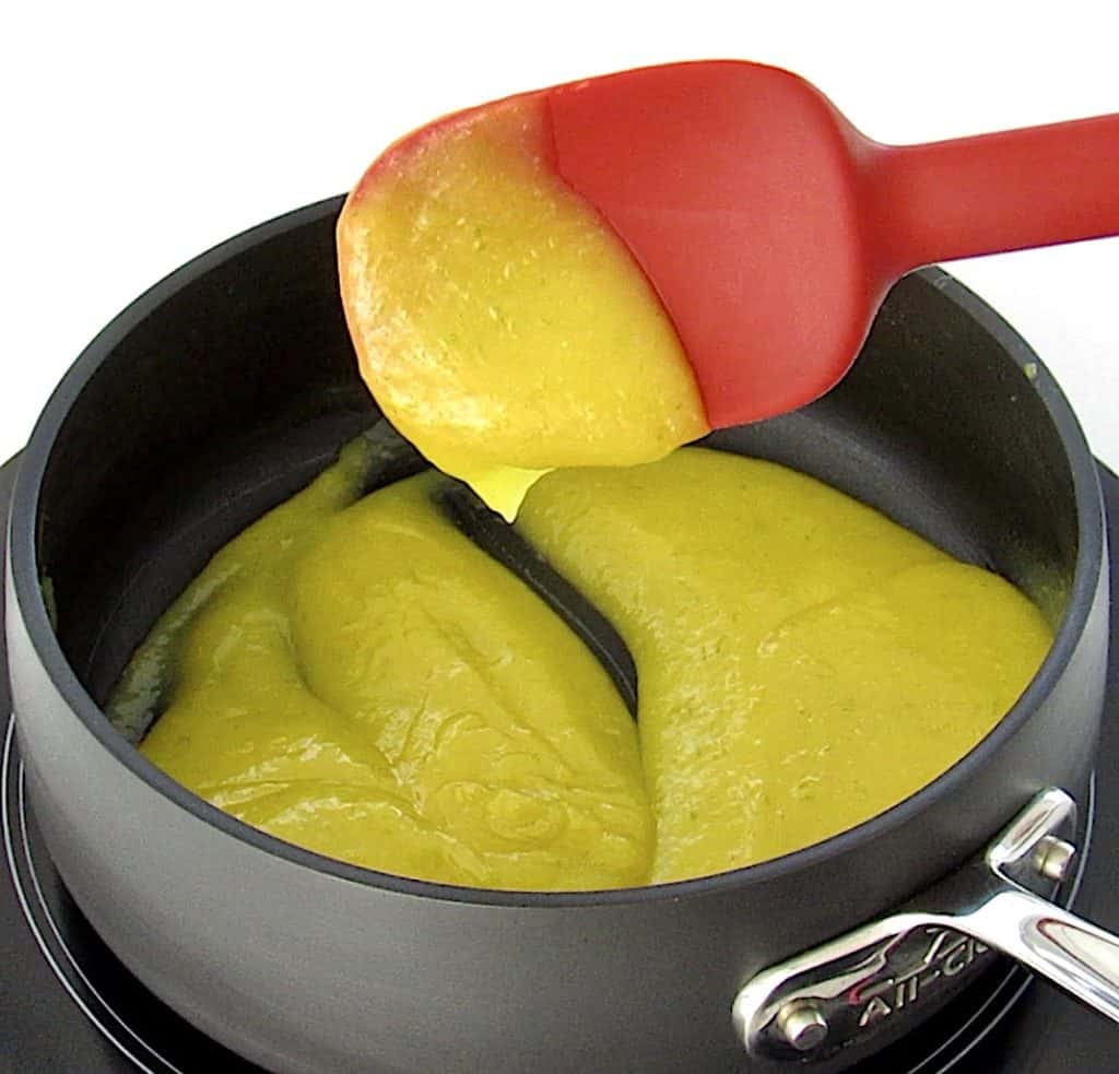 key lime curd in saucepan with red spoon