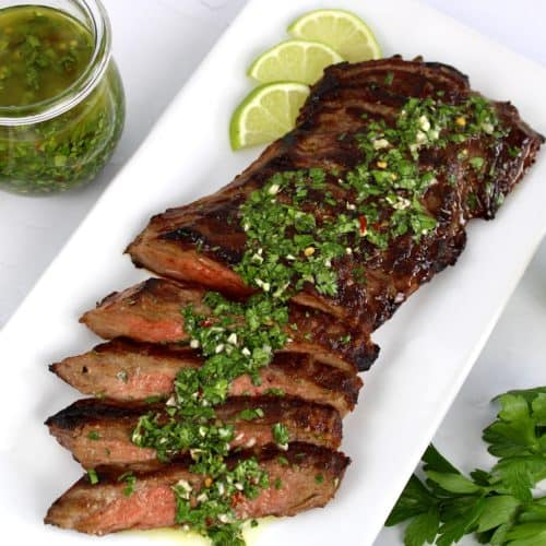 grilled skirt steak sliced with chimichurri sauce on top