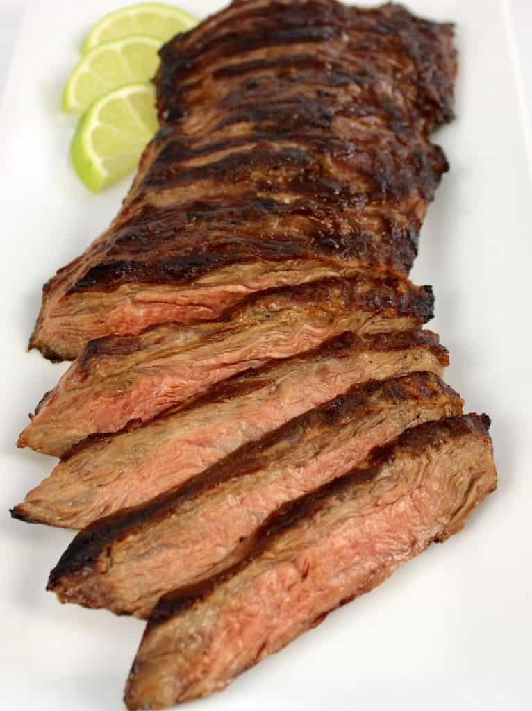 sliced skirt steak on white plate