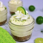 Keto No Bake Key Lime Cheesecake in glass jar with lime on top