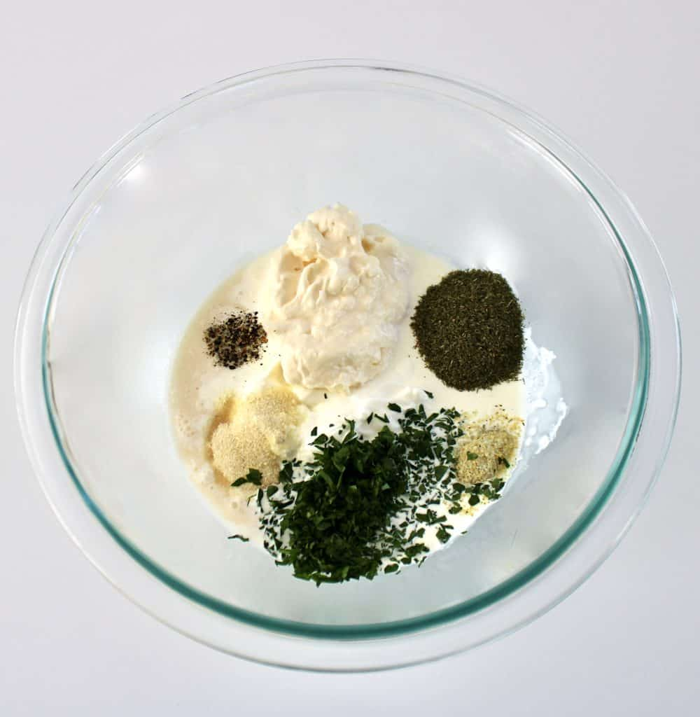 ingredients for ranch dressing in glass bowl unmixed