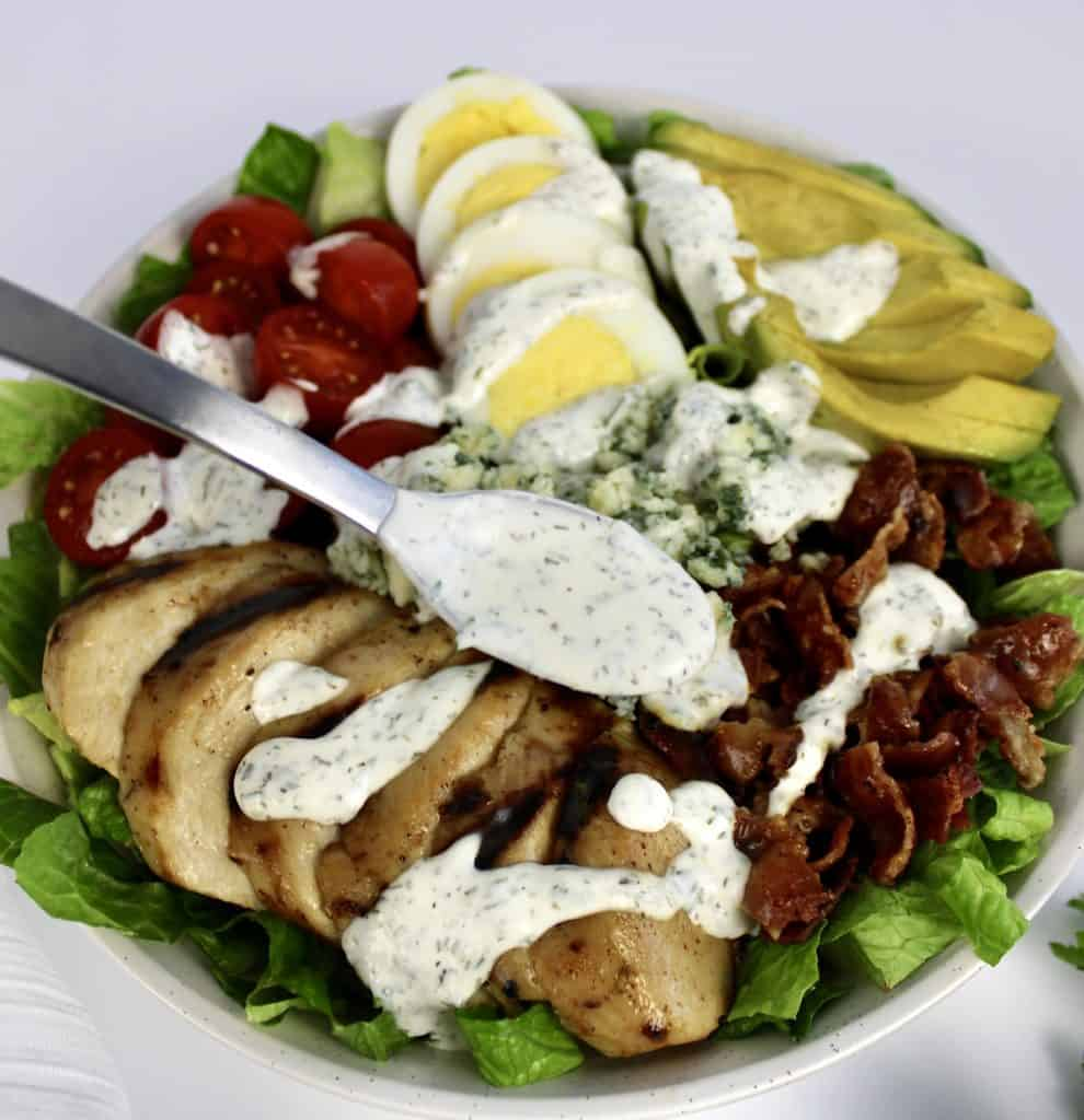keto ranch dressing being spooned over cobb salad