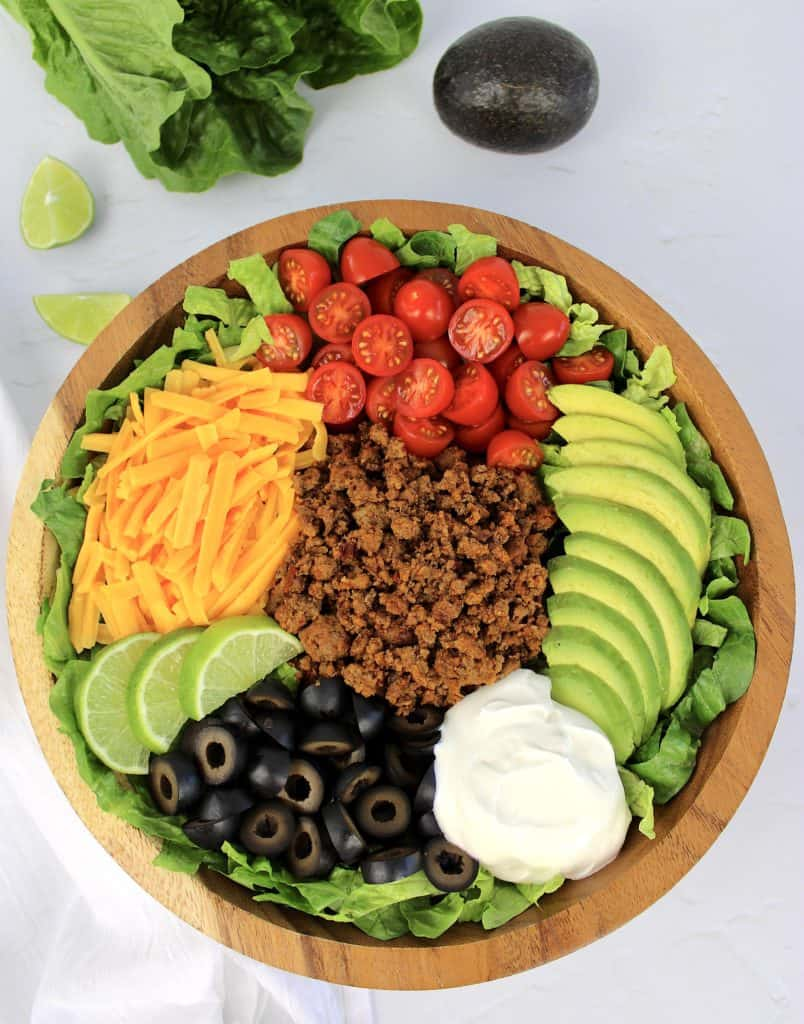 overhead view of taco salad in wooden bowl