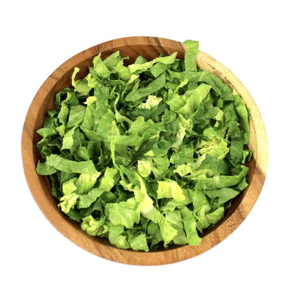 shredded romaine lettuce in wooden bowl