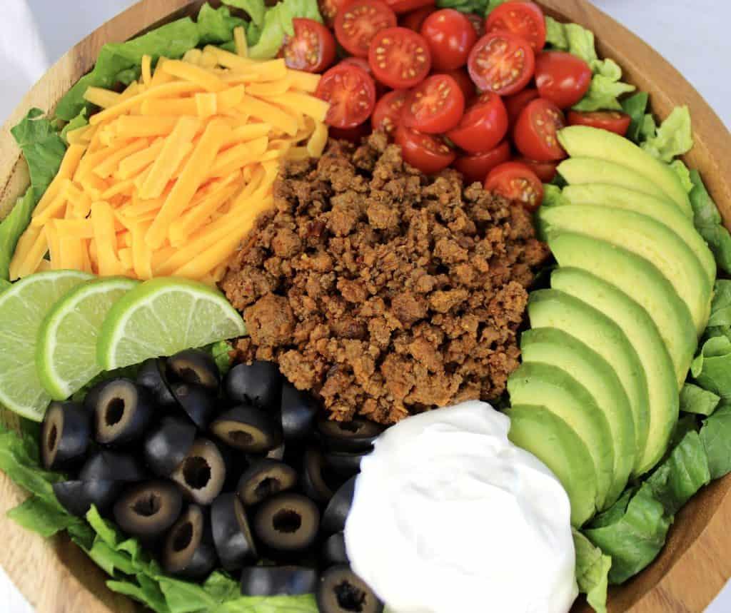 closeup of taco salad in wooden bowl