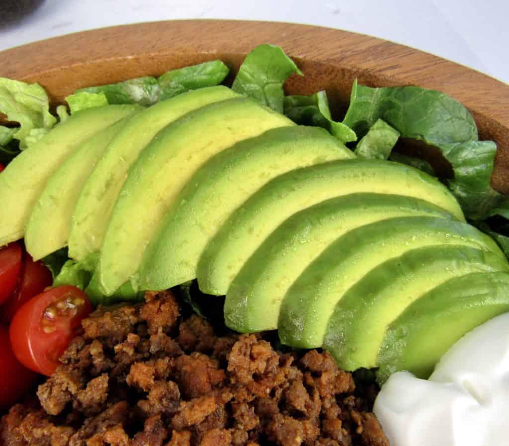 sliced avocado on taco salad