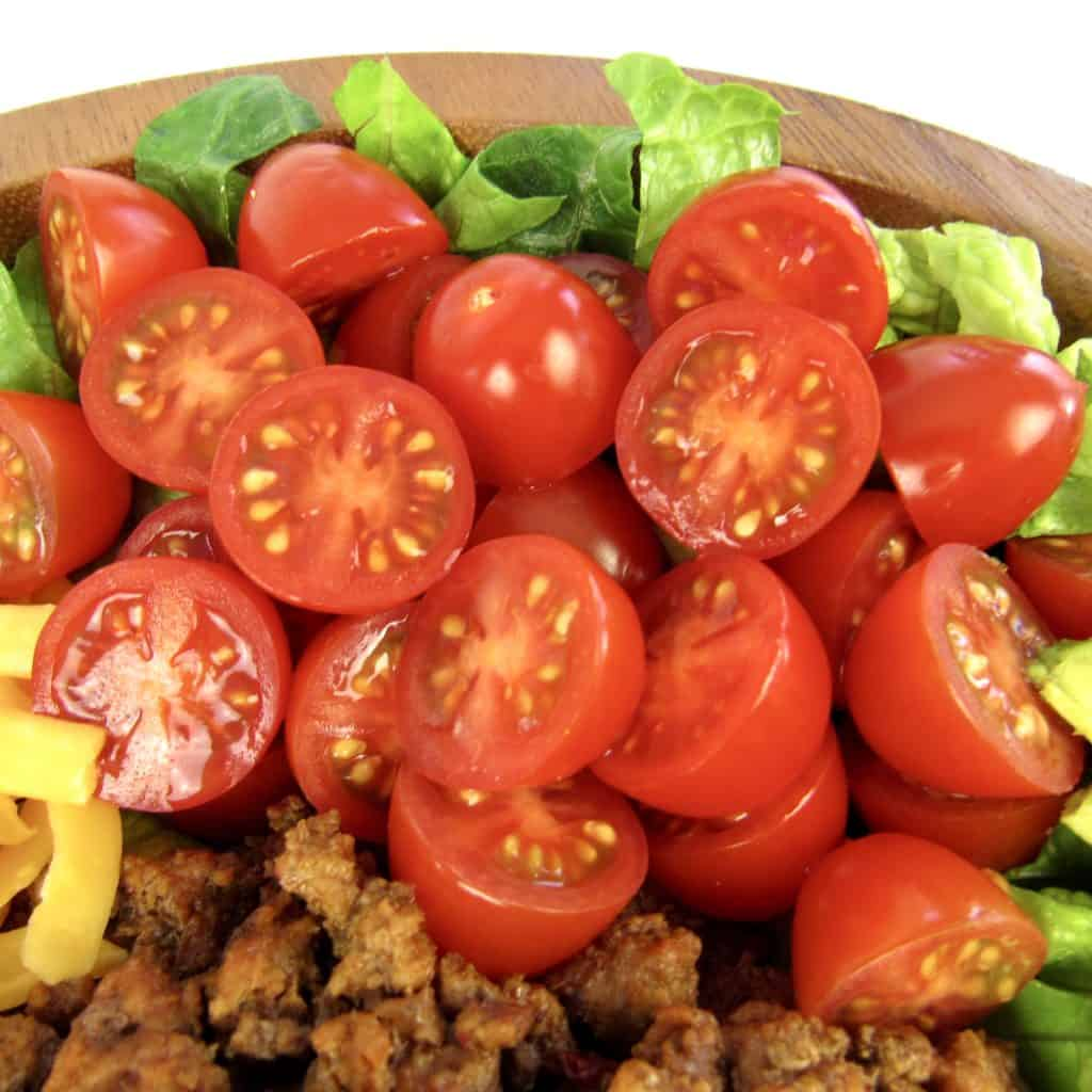 cherry tomatoes cut in half on salad