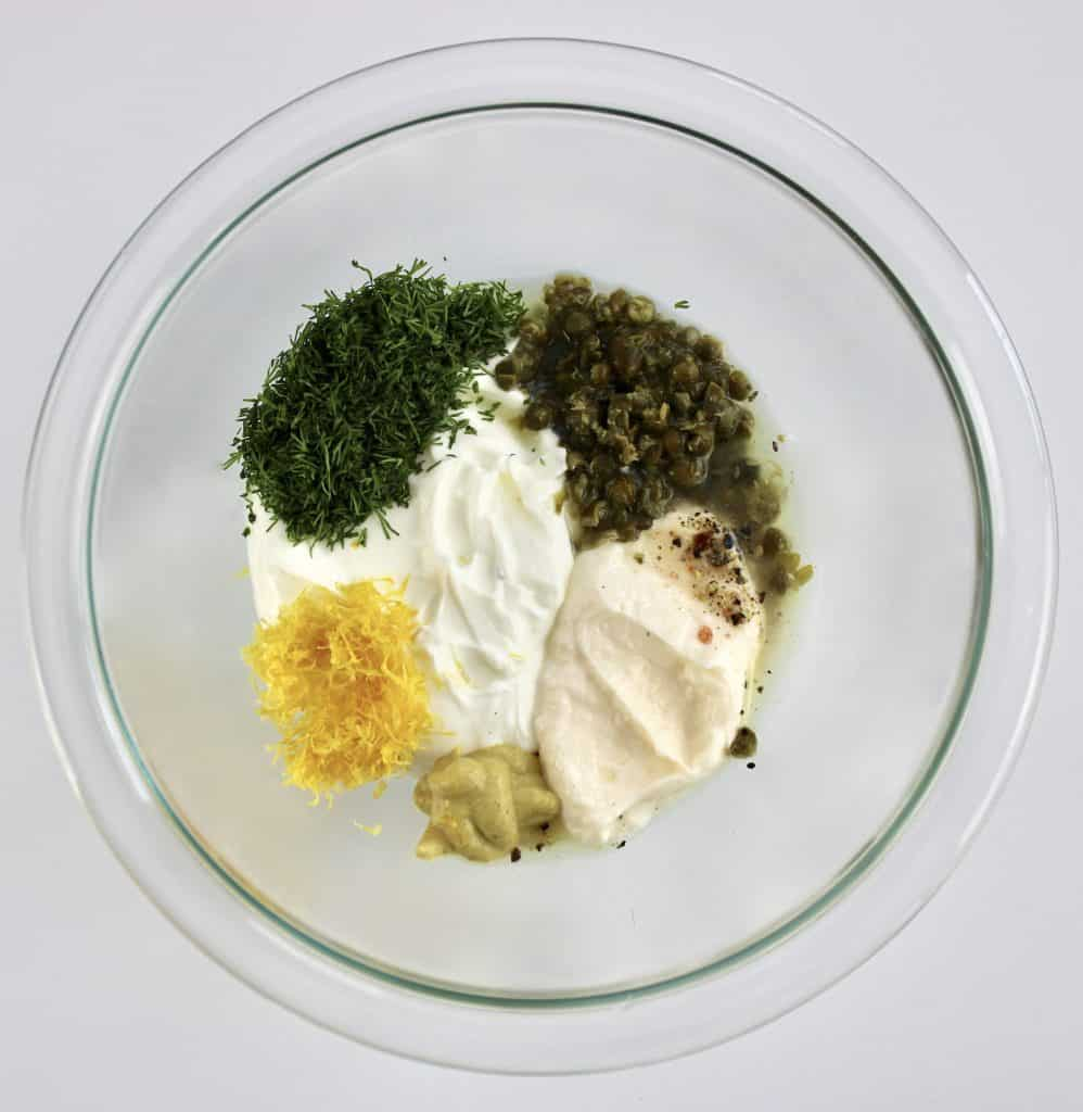 creamy dill sauce ingredients in glass bowl unmixed