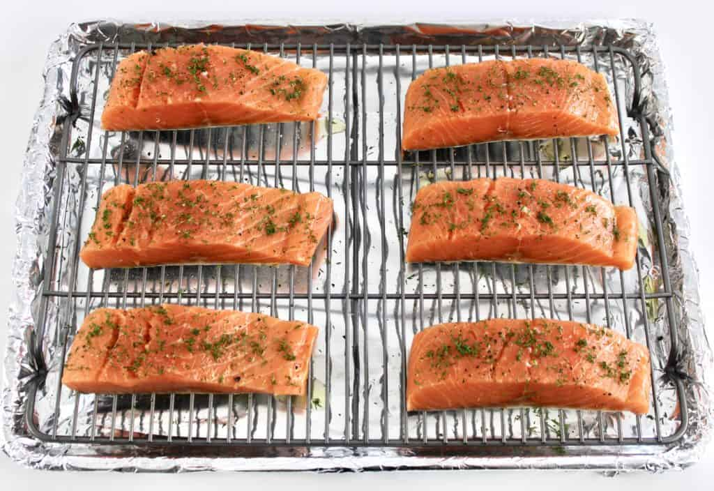 6 pieces raw salmon on baking rack