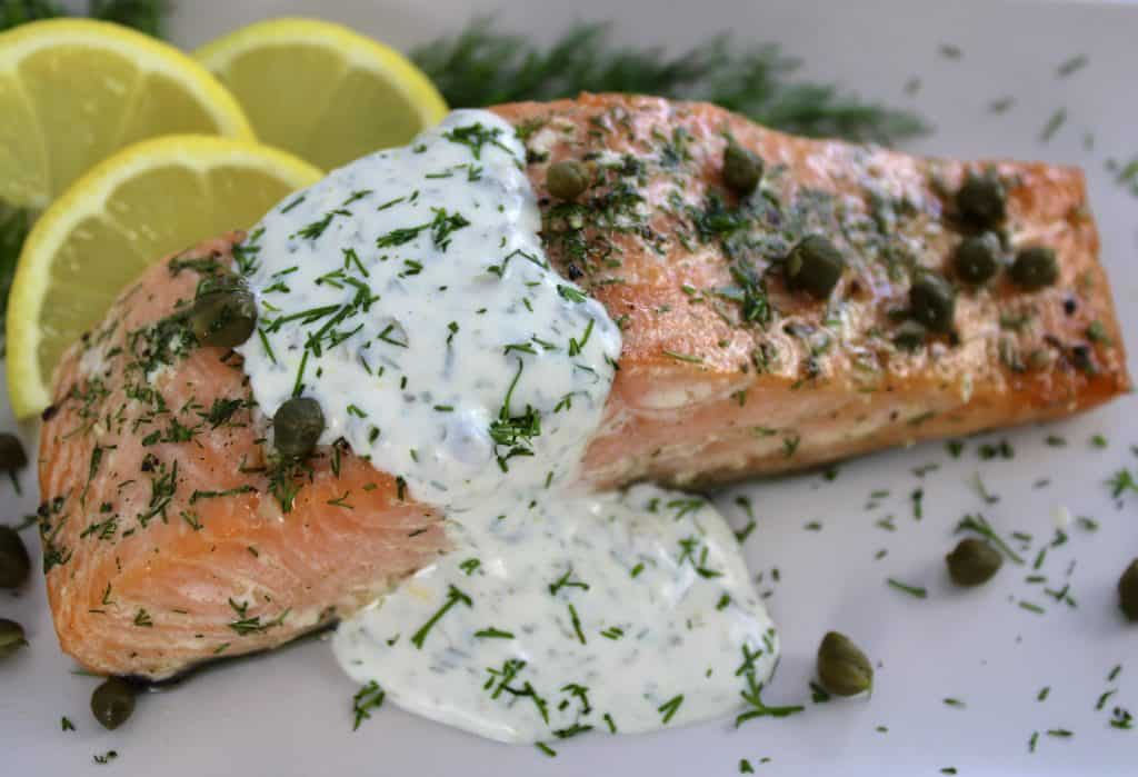 closeup of Baked Salmon with Creamy Dill Sauce on plate