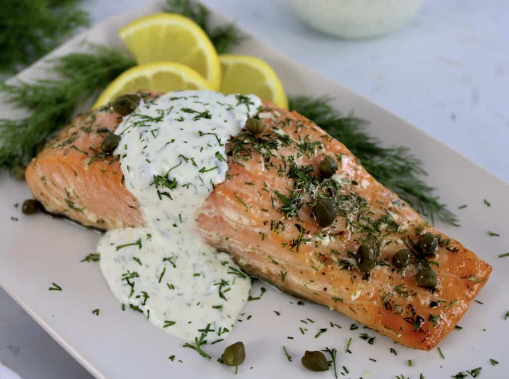 Baked Salmon with Creamy Dill Sauce on white plate