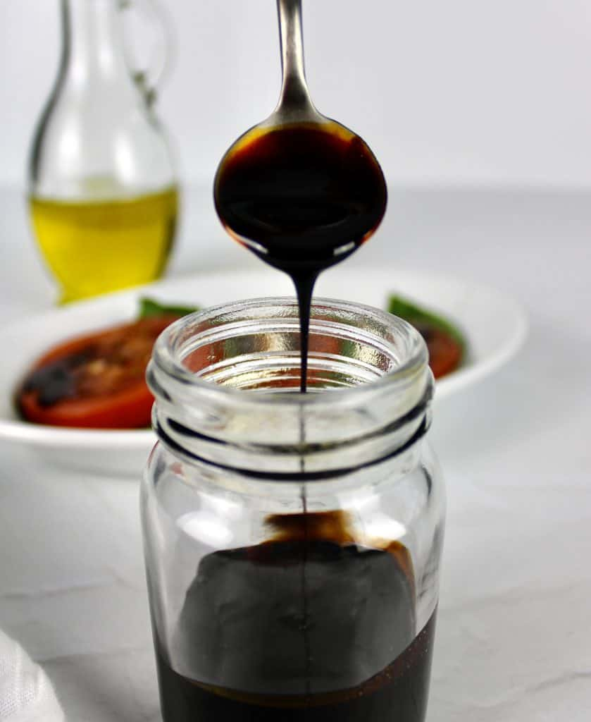Balsamic Reduction dripping off spoon in jar