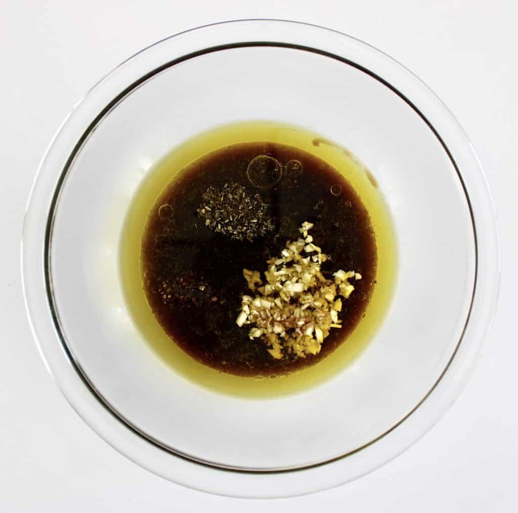steak marinade ingredients in glass bowl