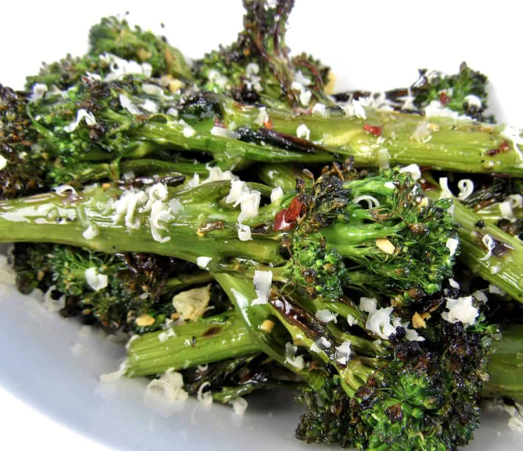 closeup of grilled Broccolini with parmesan cheese on top