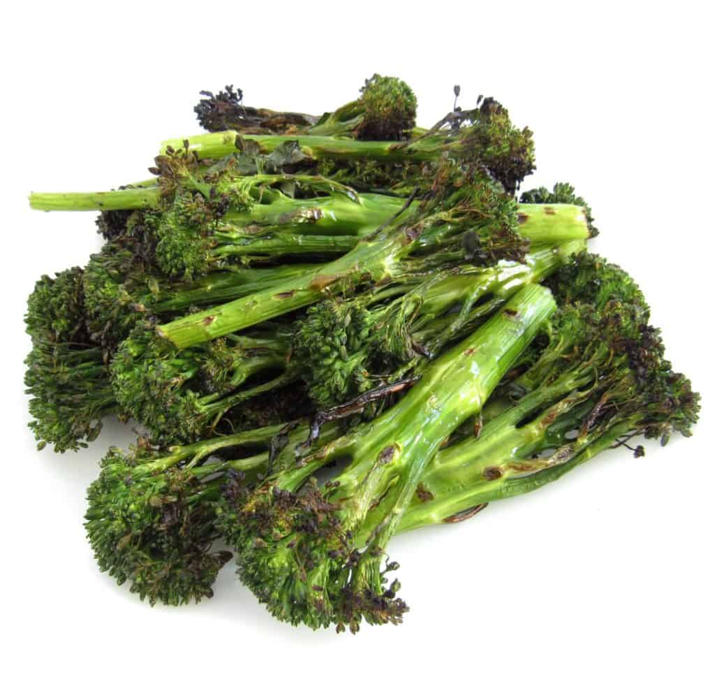 Grilled Broccolini on white dish