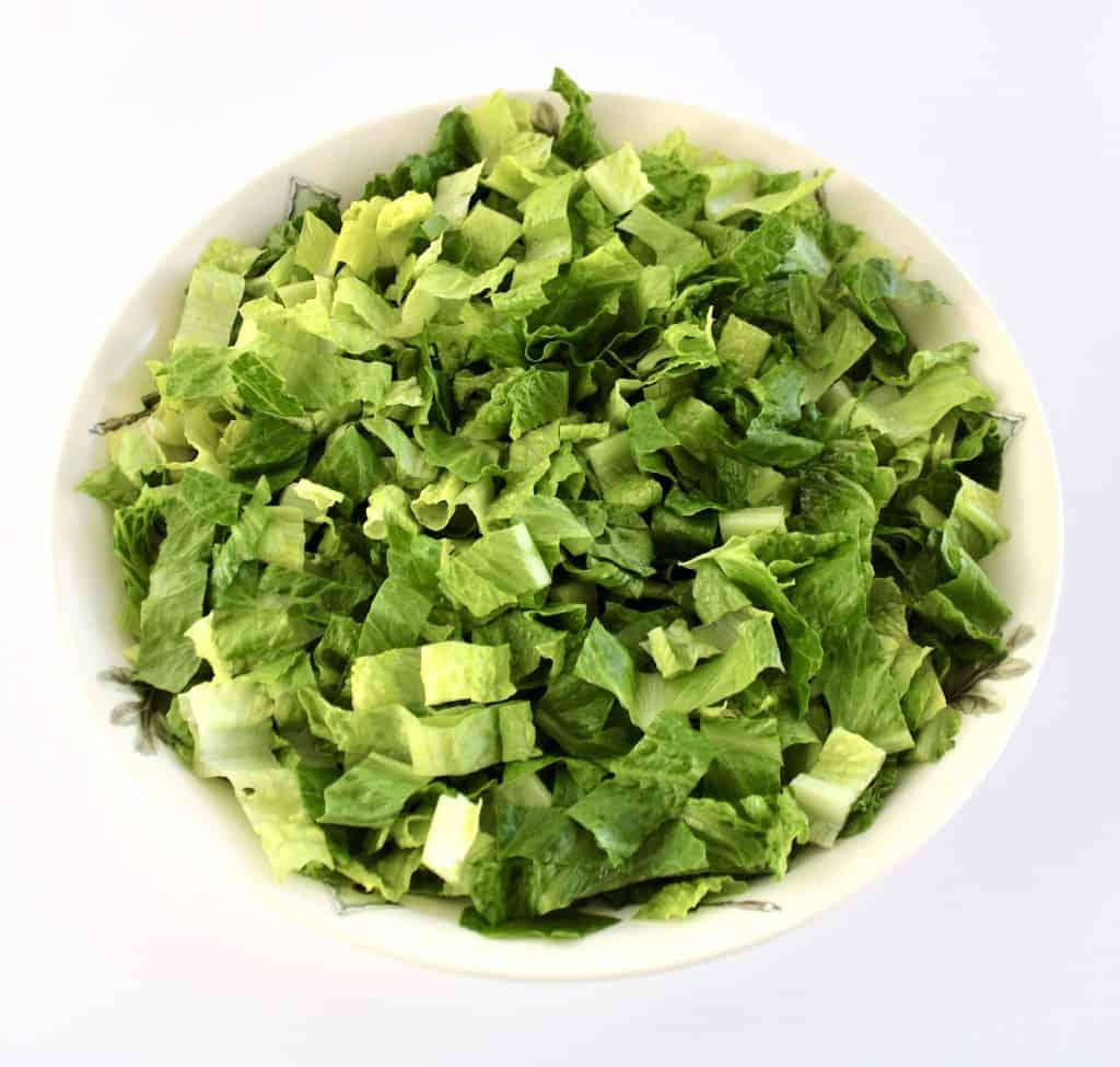 bowl with shredded romaine lettuce