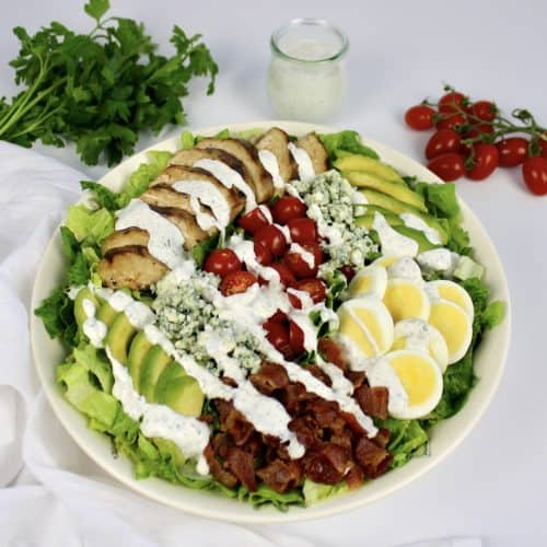 Keto Cobb Salad with Ranch Dressing drizzled on top