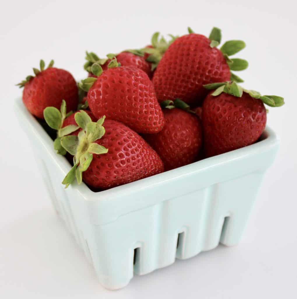 fresh strawberries in blue container