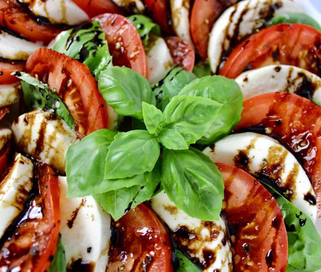 Caprese Salad with Balsamic Reduction closeup of basil on top