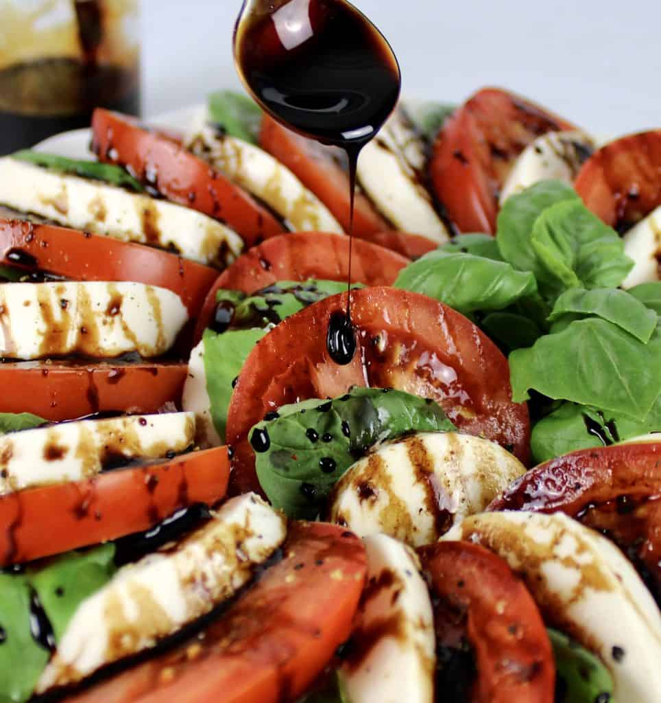 Caprese Salad with Balsamic Reduction being drizzled over top
