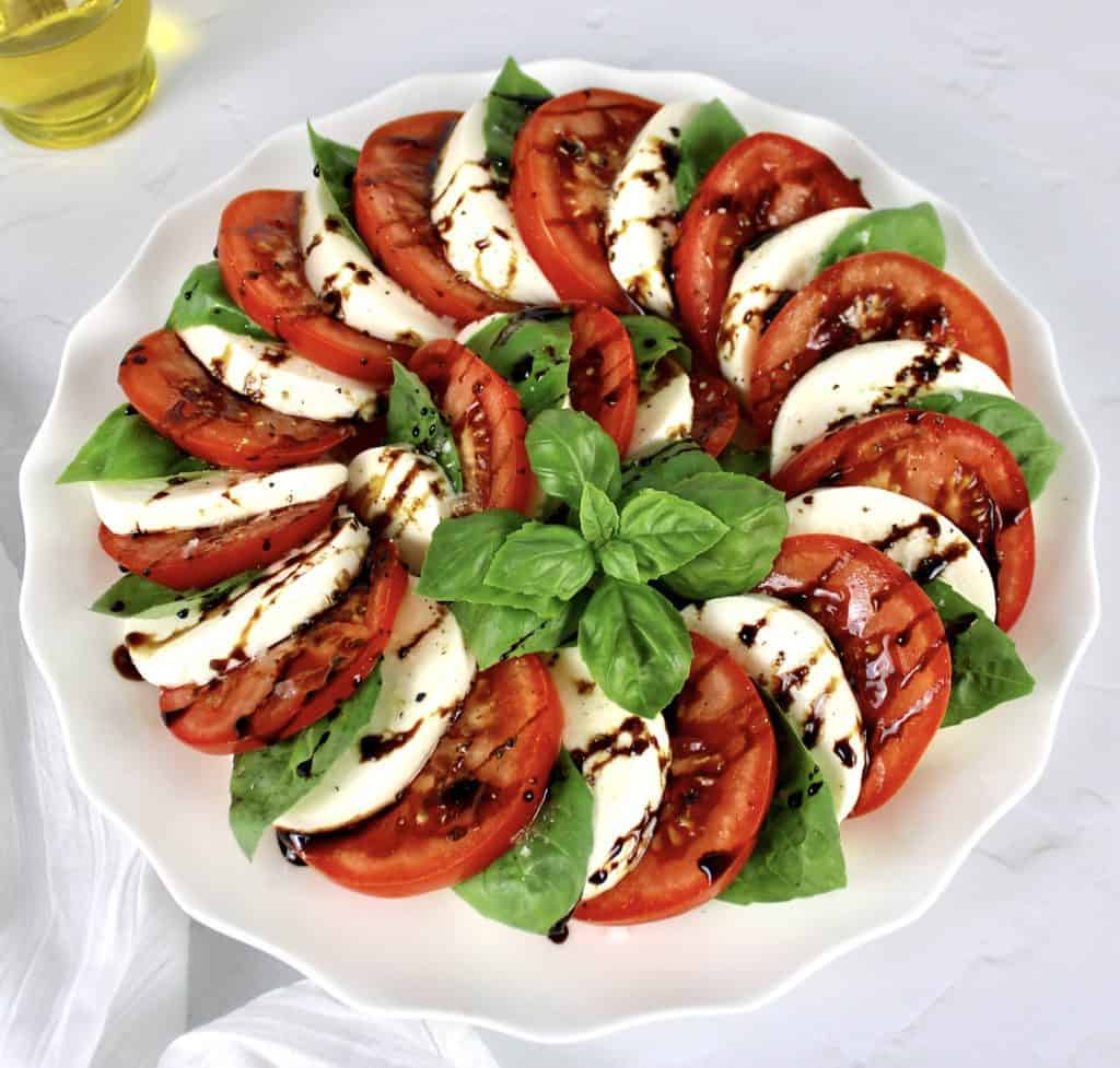 Caprese Salad with Balsamic Reduction on white plate