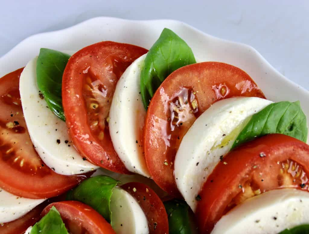 Caprese Salad closeup on white plate