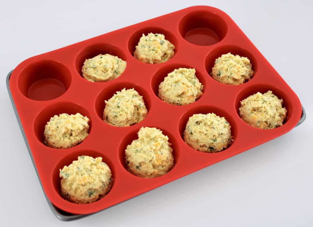 Cheddar Ranch Keto Biscuits raw in red muffin pan