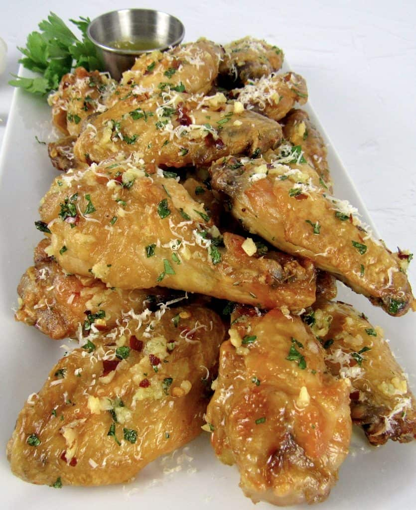 Air Fryer Garlic Parmesan Wings on white platter with parsley on top