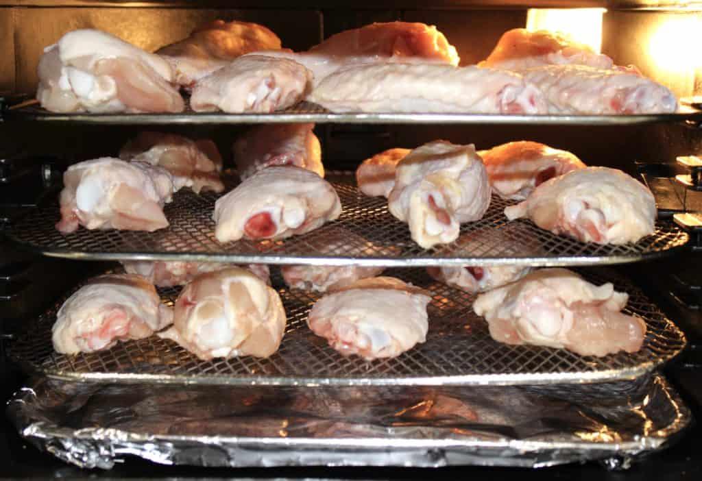 raw chicken wings on air fryer racks