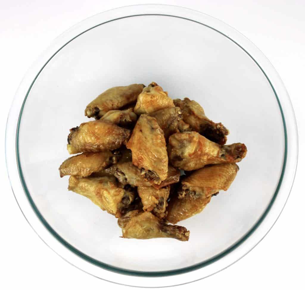 crispy chicken wings in glass bowl