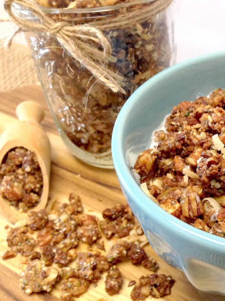 Coconut Granola in blue bowl with granola in background