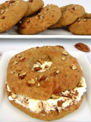 pumpkin bagel with cream cheese on white plate