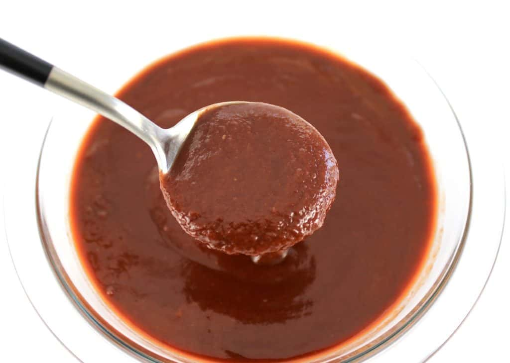 Keto Raspberry Chipotle BBQ Sauce in glass bowl with spoonful