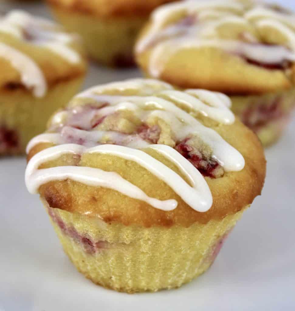 closeup of Keto Strawberry Lemonade Muffin on white plate