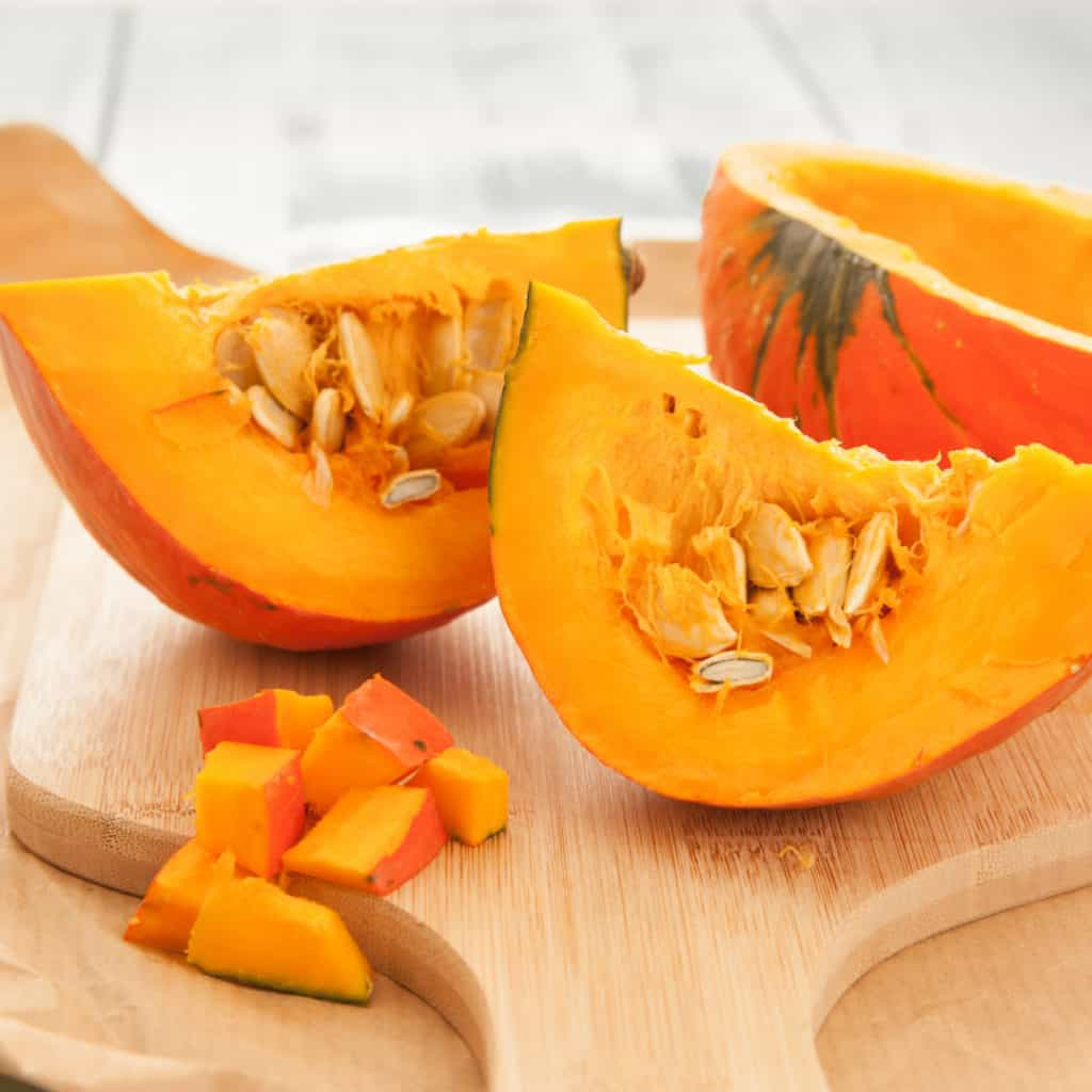 Pumpkin cut up on cutting board