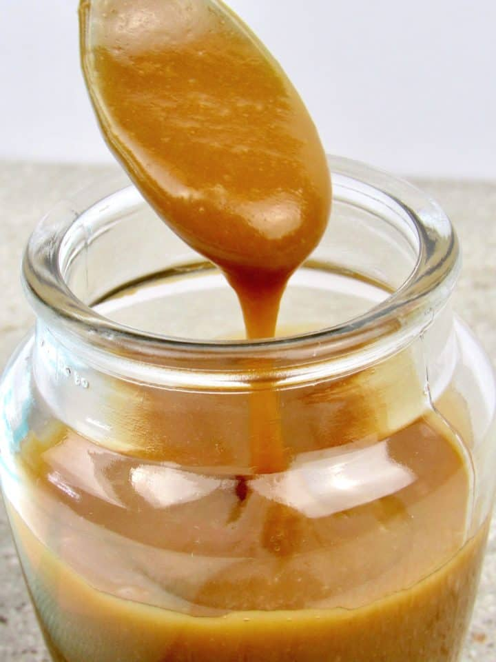 Salted Caramel Sauce being spooned out of jar