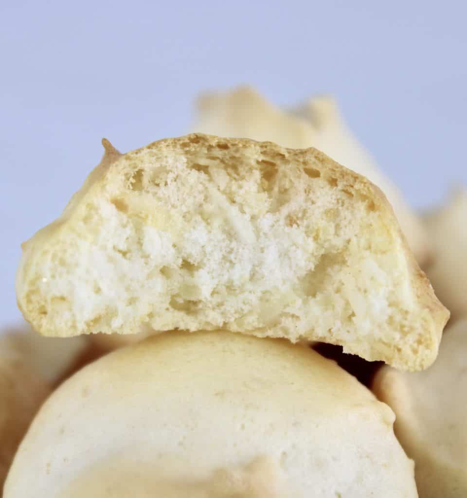 closeup of coconut meringue cookie with bite taken out