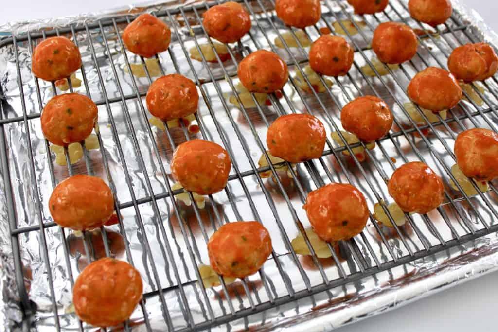 baked buffalo chicken meatballs on baking rack