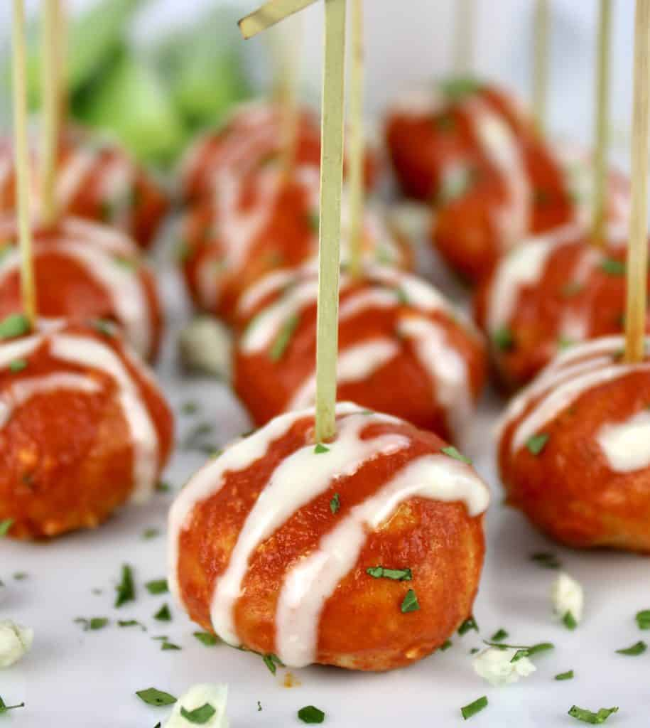 Keto Buffalo Chicken Meatballs with toothpicks on white plate