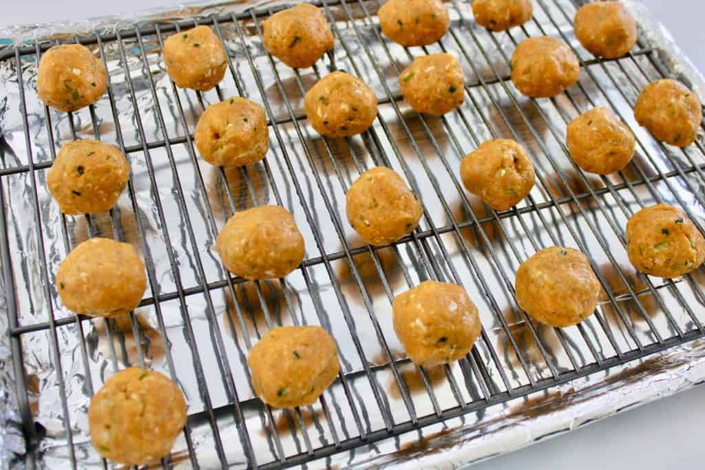 raw buffalo chicken meatballs on baking sheet