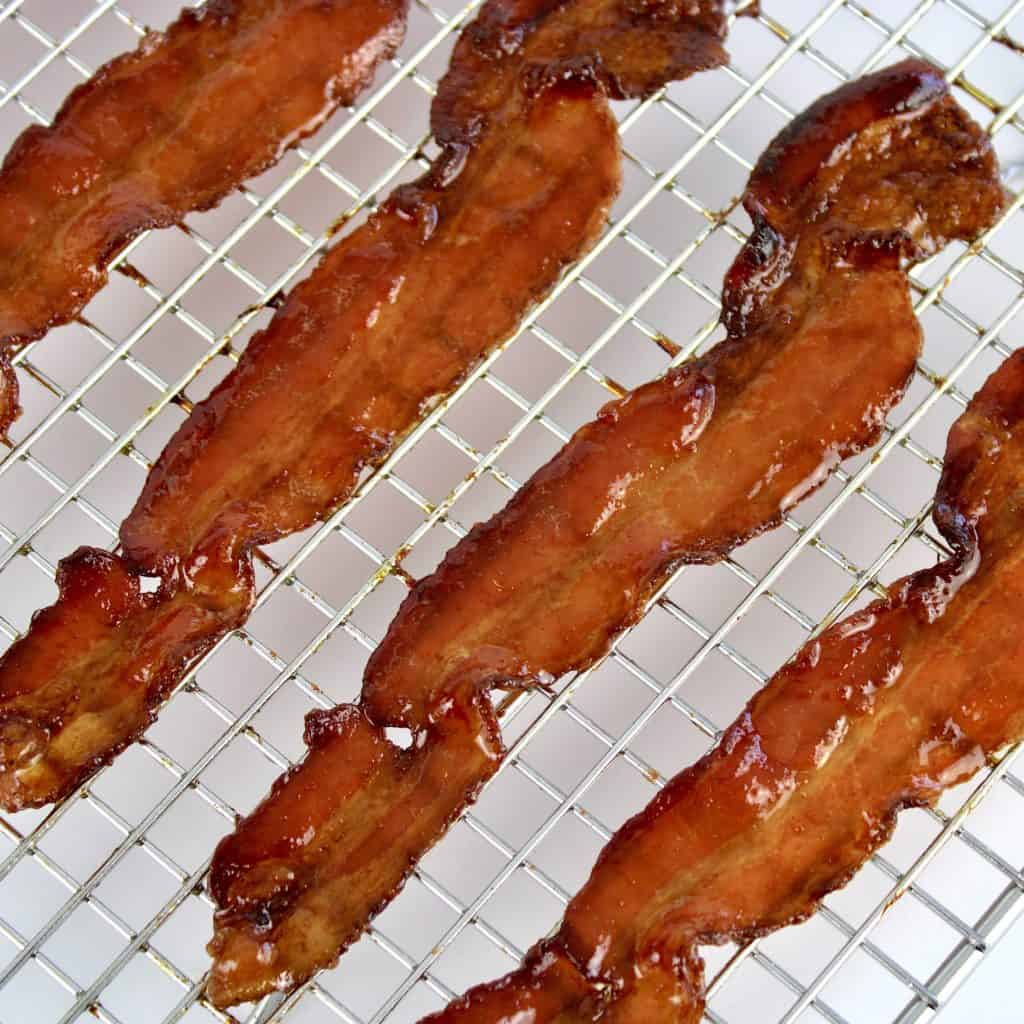 closeup of candied bacon on rack